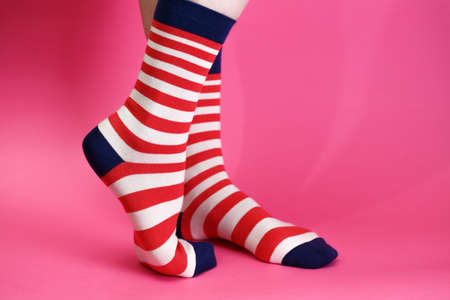 striped bright socks on a pink background Stock Photo