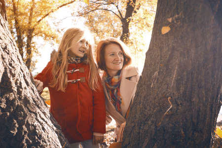 happy family.  smiling mom and daughter in the autumn park. Stock Photo