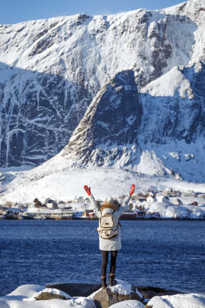 winter. girl walks along the shore of the fjord. Lofoten islands. Norway