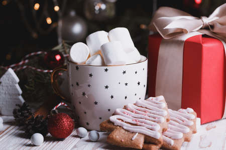 cup of coffee and marshmallows. Presents, gingerbread and Christmas decorations