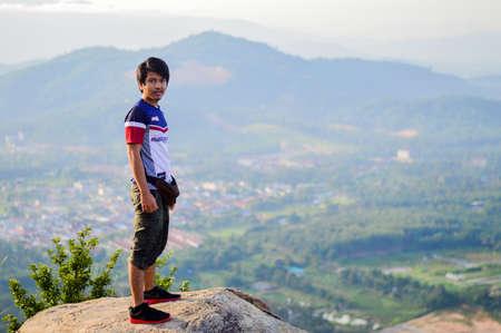 Broga Hill, Semenyih Negeri Sembilan, MALAYSIA - 22 August 2015. A bunch of people hiking and doing an outdoor Merdeka activity at Broga Hill, Semenyih Negeri Sembilan, Malaysia.