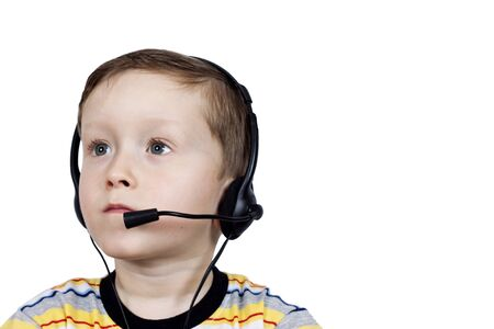 a little boy in headphones with a microphone on a white background Stock Photo - 12798880