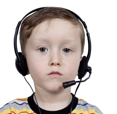 describe: boy with headphones with a microphone close up Stock Photo