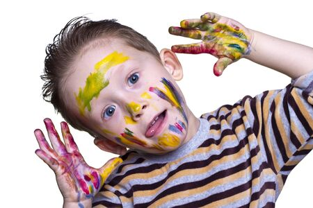 belonging to the caucasoid race: a happy little boy with a cute face smeared paint on a light background Stock Photo