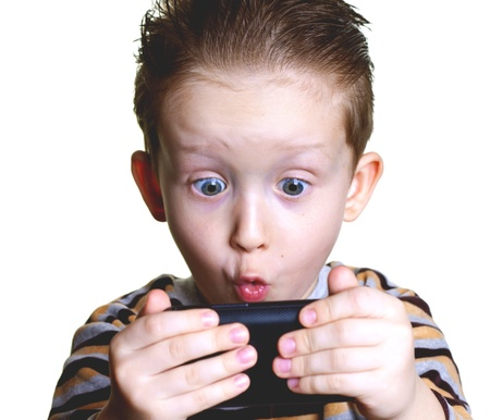 consciously: boy on a white background with surprise reads the message on your phone Stock Photo