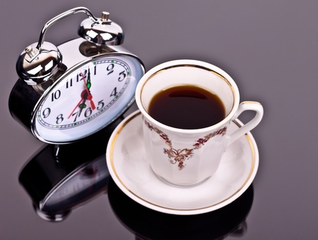 cup of coffee and watch the table on a dark background Stock Photo - 13247983