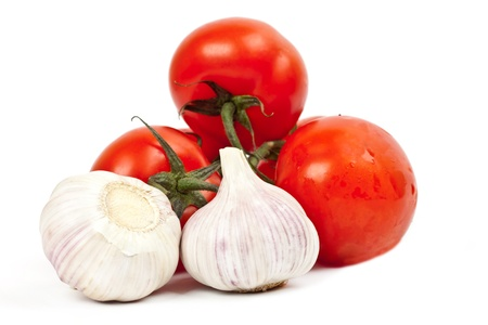 tomatoes and garlic on a light background Stock Photo - 13372347