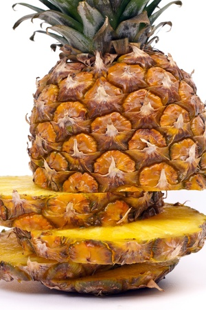 ripe pineapple sliced on a light background photo