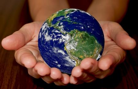 environmen: Globe in womens hands
