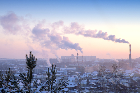carbon pollution: factory pipes on a background of the city