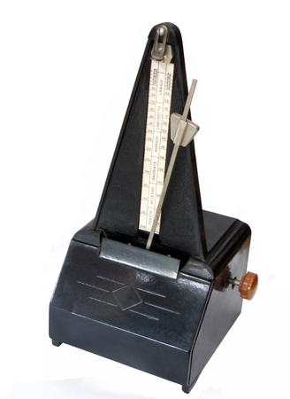 Metronome old white background