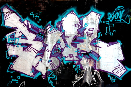 old brick wall vandalized with graffiti street art. Urban culture abstract background.
