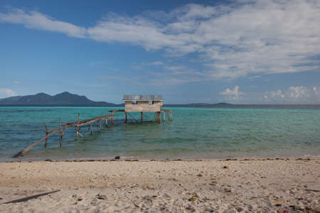 jetty: house and jetty with background an island