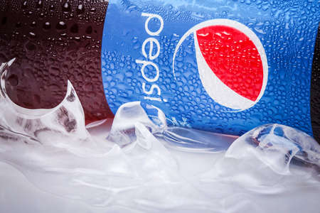 dewed: SABAH, MALAYSIA - JANUARY 13, 2015: Can of Pepsi drink isolated on white. Pepsi is carbonated soft drink produced by PepsiCo. Pepsi was created and developed in 1893 Editorial