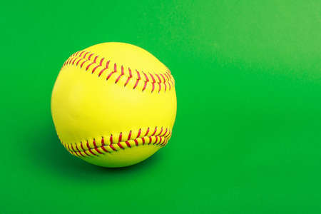 sphere base: softball ball isolated on green background