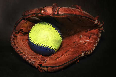 sphere base: Closeup of a Softball Glove and ball