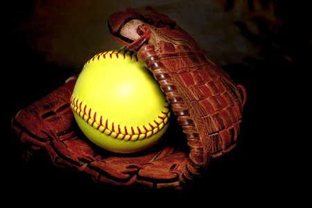 sphere base: Closeup of a Softball Glove and ball