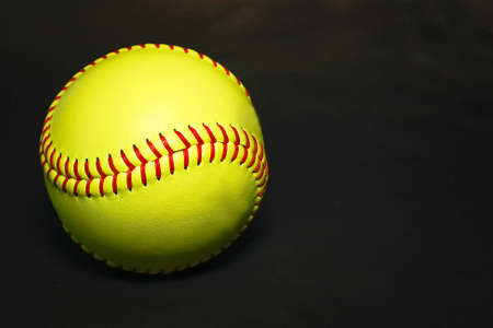 softball ball isolated on dark background
