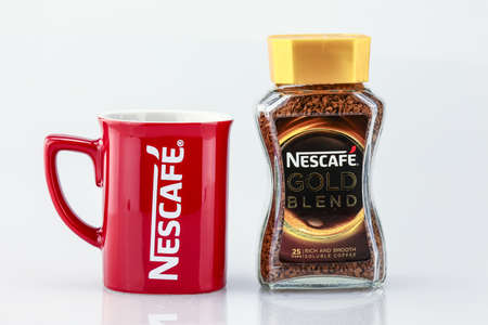 instant coffee: KUALA LUMPUR, MALAYSIA - JUNE 14TH, 2016. Nescafe is a brand of instant powdered coffee made by Nestle S.A, a Swiss multinational food and beverage company, first introduced on April 1, 1938. Stock Photo