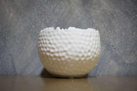 Broken golf ball for ash tray. Stock Photo