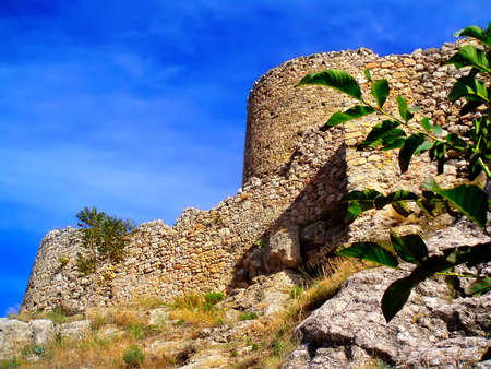 upward struggle: The ancient Genoese fortress in Crimea against the blue sky