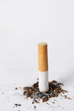 quiting smoking: Putting out a cigarette on a white background.