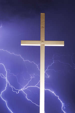 Lightning Thunderstorm and a religious cross. Vertical image photo