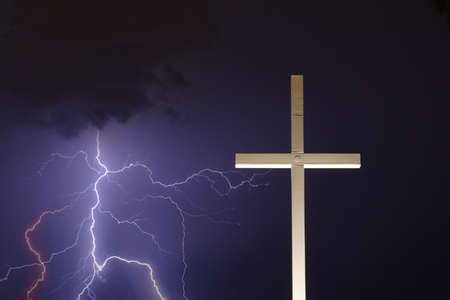 Lightning thunderstorm and a religious cross photo