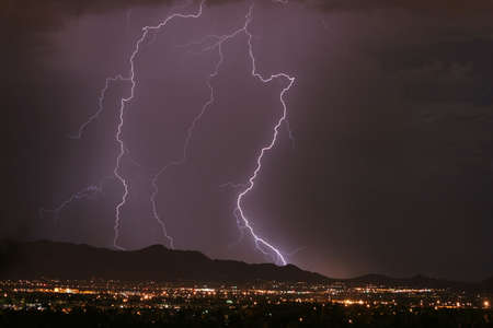 striking: Lightning striking the mountains, Purple in color.