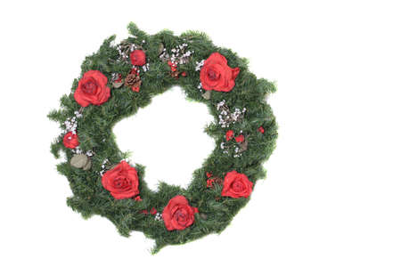 Christmas Wreath with red roses and  breath on a white background. photo