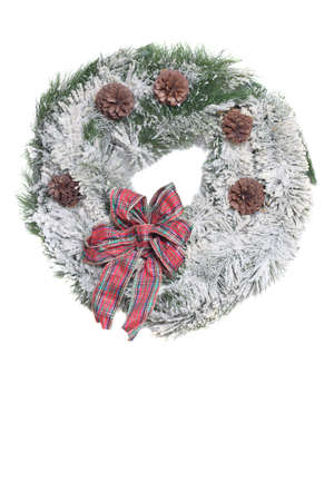Flocked Christmas Wreath with red bow on a white background. Stock Photo - 642797