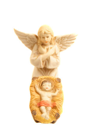 jesus standing: Religious nativity scene with baby Jesus in the stable and angel standing over him.