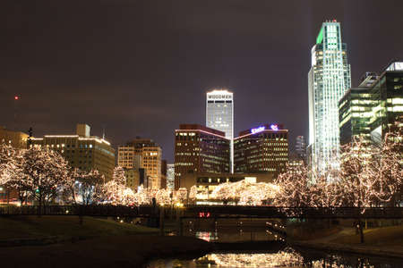 lite: Omaha Trees lit up in white Lights in the city with reflection in the water. Stock Photo