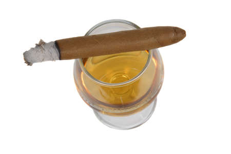 sniffer: Cigar with white ashes on a sniffer glass with brandy. Isolated on a white background.