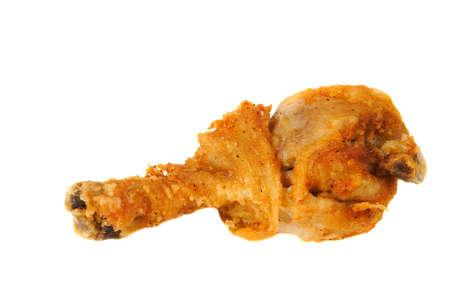 Crispy Golden brown fried chicken leg on a white background.