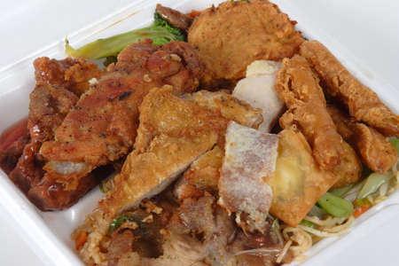 Chinese Buffet Take out container filled to the top with chicken, beef,pork,rice,noodles and egg rolls.  Stock Photo - 848100