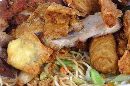 All you can eat chinese buffet with noodles,rice,chicken,beef,pork and egg rolls.  Stock Photo