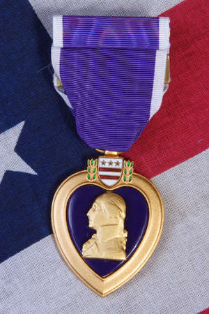 honours: American Purple Heart Medal on a USA red white and blue Flag Background. Stock Photo