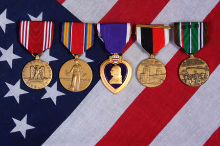 honored: American War Medals on a USA red white and blue Flag Background.  Stock Photo
