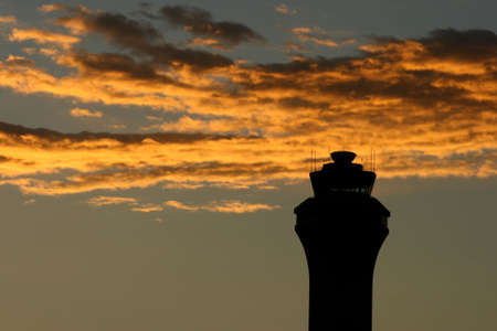 air traffic: Colorful Sunset sky and an air traffic control tower.  Stock Photo