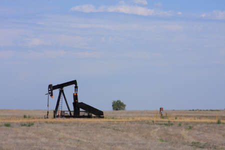 beam pump: A Pumpjack pumping oil from an oil well out in the plains.