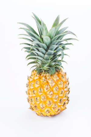 Yellow pineapple isolated on white background