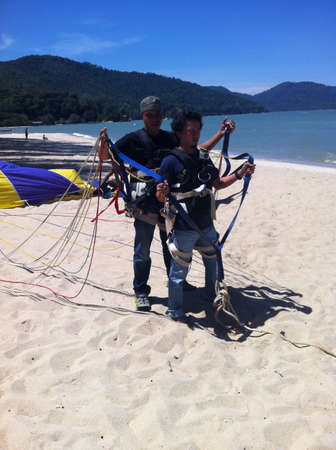 Two man fly with parasailing Stock Photo - 21999204