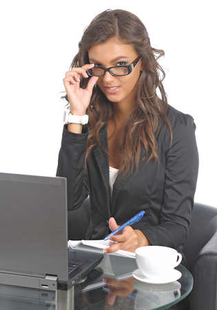Cute young businesswomen at her desk photo