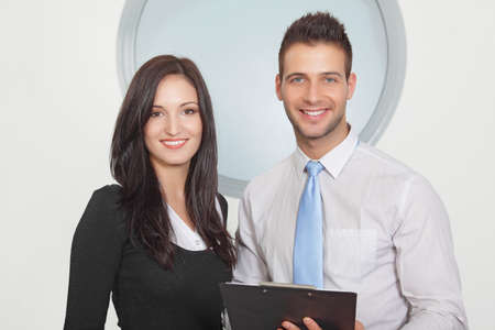 Two businessperson standing and smiling Stock Photo