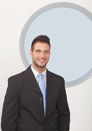 Businessman smiling in the office photo