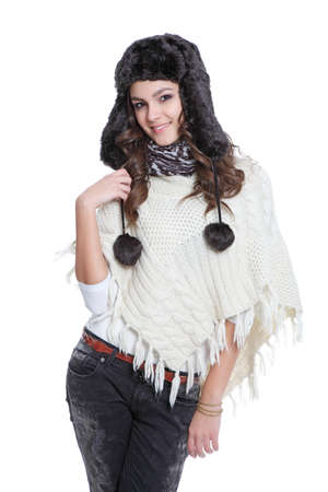 Attractive brunette posing with fur hat photo
