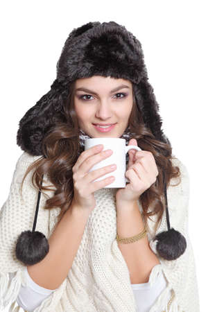 Cute brunette with hat and a cup