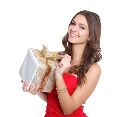 Red dressed women with a gift Stock Photo - 11738169