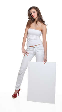 Young brunette showing a blank board Stock Photo